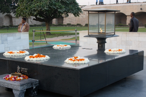 The tomb of Mahatma Gandhi. It has an eternal flame as well and is located in a very grassy beautiful park.